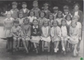 Mrs Howard and her pupils 1950s