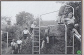 School children on climbing frame July 1956