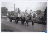 Fancy dress parade passing the old 'Plough'
