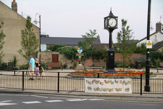 Chatteris In Bloom with Town Sign