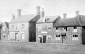 """East Park Street, Chatteris. 2 women chat in door of """"Prince of Wales Feathers"""" public house"""