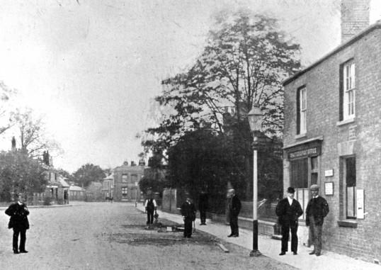 Chatteris Post Office & Park Street towards Market Hill. Shop now Hollies Dentists.