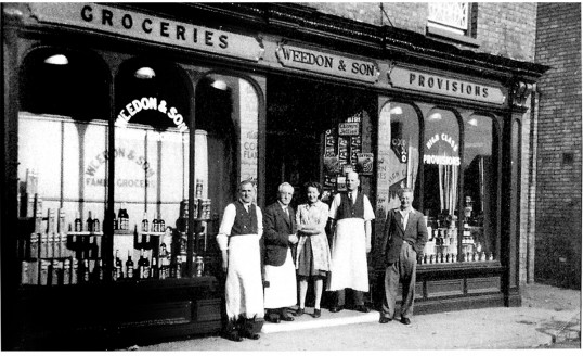 3 generations of Weedons at their shop , 7 Park Street, Chatteris. Currently a Tandoori take-away.