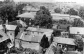 Bramley & Chatteris Houses as seen from Church tower over backs of shops on north side of Market Hill. Lindsells brewery chimney to rear.