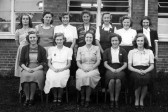 11 prefects pose with Mrs Gladys Barrett at The Cromwell Secondary Modern Girls School, Wenny Road, Chatteris.