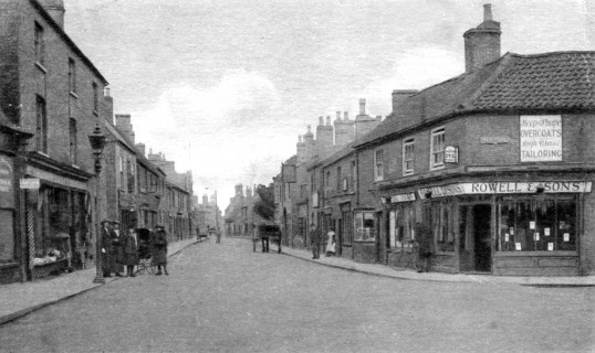 High Street, Chatteris. Rowell menswear shop at  junction with New Road. Chatteris Museum collection.
