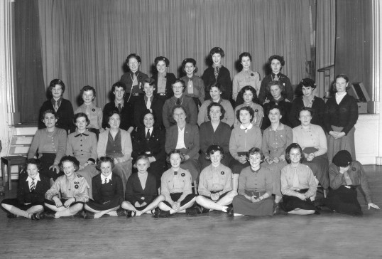 Group photo of some members of Chatteris Guides group on their 21st anniversary. From Rita Goodger scrapbook in the museum collection