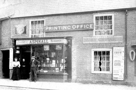 Printer William Aspinall at his shop, 10 High Street Chatteris. Photo from Grahame Aspinall collection in Chatteris museum.