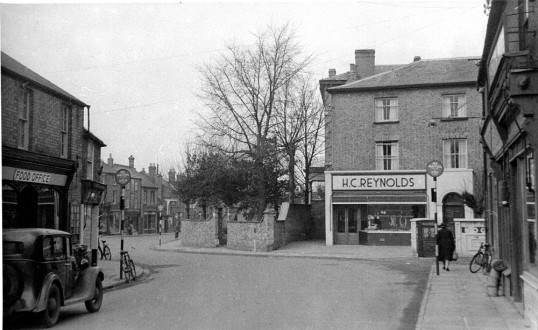 Wartime Food Office & H C Reynolds, butchers shop, on opposite sides of High Street Chatteris. Maurice Kidd photo in museum collection.