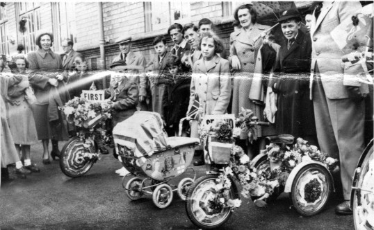 Damaged photo of Decorated cycle competition in Chatteris Queen Elizabeth II Coronation events. Chatteris museum collection