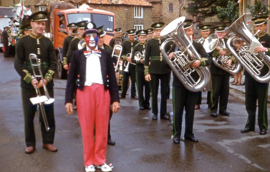 Chatteris Silver band prepare to lead the Chatteris Coronation parade. Maurice Kidd photo in Chatteris museum collection.