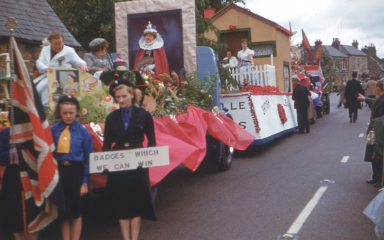 Girl Guides, WI and British Legion floats prepare for Chatteris Coronation Celebration parade. Maurice Kidd photo from Chatteris museum collection.