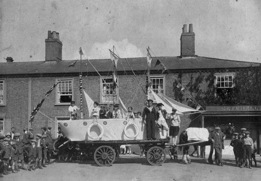 HMS Victory float in Chatteris WW1 Victory parade outside Setchell's butcher shop in Market Hill. Chatteris museum photo.