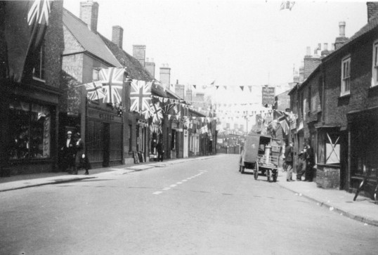 Chatteris High Street showing King George VI coronation decorations & King William IV public house. Chatteris museum collection photo.