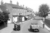 Busy Chatteris High Street opposite Chatteris House. Photo from Chatteris museum collection.