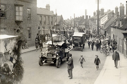 Motorised floats in Chatteris 'Hospital Sunday' parade through the High Street. First 'Spade & Becket. pub on right. Chatteris museum photo.