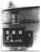 Baker, Fred Laws, outside his shop in High Street, Chatteris . The building has since been demolished.