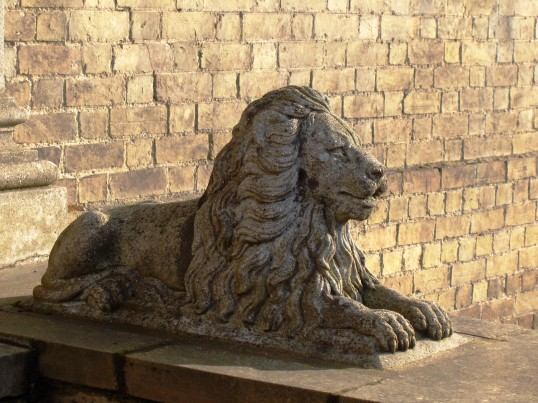 Stone lion outside house