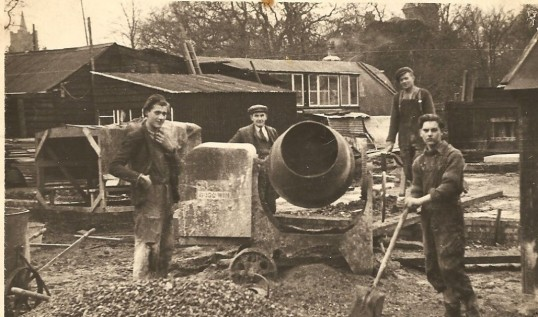 F.H Bristow's (builder) workmen. Photo taken in St Martin's Rd. Church spire and Vicarage tower visible in background. Photo courtesy Mr D Bristow.