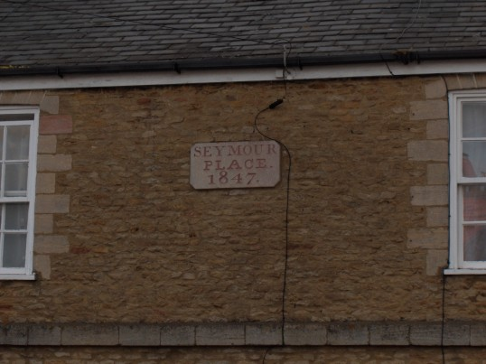 Plaque on cottages along London Road, Chatteris- Seymour Place.