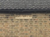 House on West Street Chatteris with plaque detailing date of rebuilding after fire in 1864.