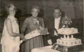 Chatteris WI celebrate 50 years since its formation. Mrs May Buitcher, president, receives bouquet from Mrs Pearl Melton.