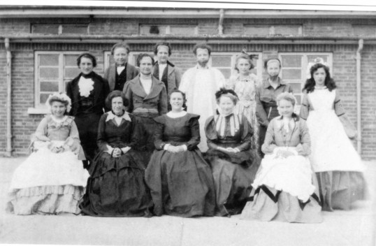 Group of females pictured outside the Cromwell School, Chatteris. They were possibly involved in a play organised by the Chatteris Women's Institute.