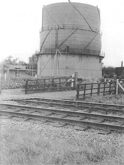 The Chatteris Gasometer. Anne Wells' father,Basil,is pictured on the walkway. The A141 has been built on the route of the railway in the photo.