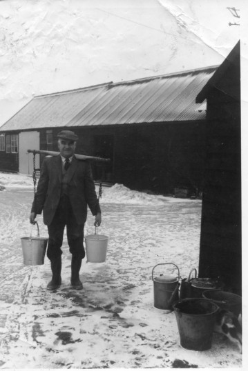 Mr Albert Gowler fetching water from Len Smith's farmyard, London Road, Chatteris after his own supply had frozen. Photo courtesy of P Gowler.