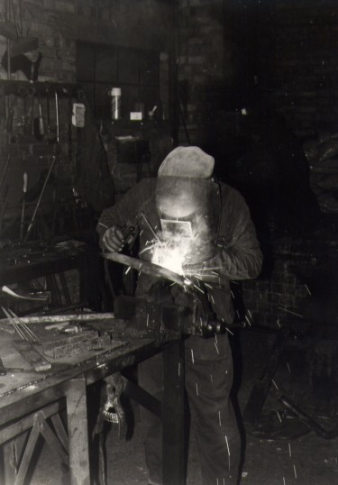 Welding in the forge that was located in the area off Railway lane, now known as Old Forge Gardens, Chatteris. Photo courtesy of T Calvert.