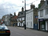 Market Hill,Chatteris, with the Nationwide Building Society & Cross Keys Inn. Flag decoration for the Festival week.