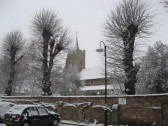 Church Lane car park with Saint Peter & Saint Paul Church in the back ground.  Easter Sunday after snow storm, Chatteris