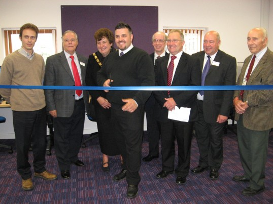 Councillor Mark Petrou cuts the ribbon to officially open the 'Vermuyden Room' at Chatteris Library