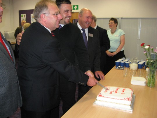 Councillors  cut the cake at the opening of the 'Vermuyden Room' at Chatteris Library