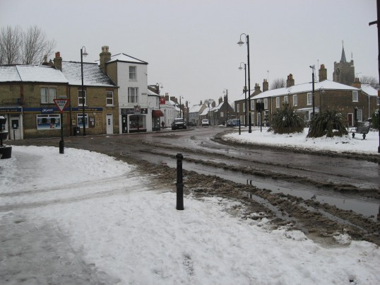East Park Street looking towards Market Hill, Chatteris on a cold snowy day with Saint Peter and Saint Paul Church,in the back ground