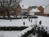 A family enjoying a snowball fight  in Juniper Drive, Chatteris
