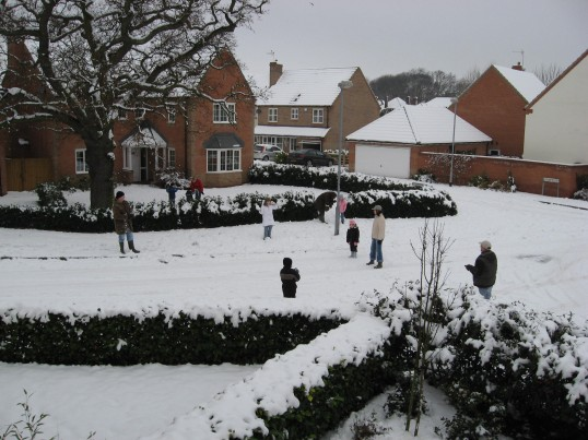 A family enjoying a snowball fight  in Juniper Drive, Chatteris