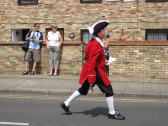 Town Crier, James Carney, heading the Chatteris Historic Festival Parade, through the town