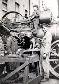 Traction engine in Chatteris with William Peggs on left, Eric Witney on right and boy is Charles Cole-Brown.