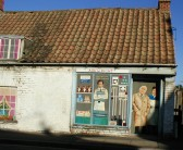 Disused sweet shop on the corner of Slade Way & High Street, Chatteris, decorated by Chatteris in Bloom. When was it last 'open all hours'?. Details