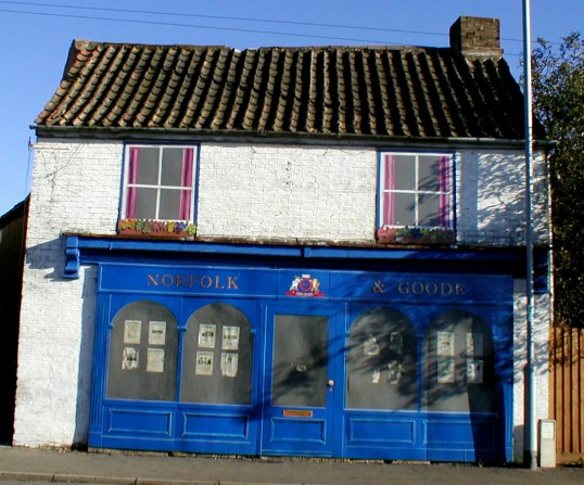 Disused shop on east side of Chatteris High Street, decorated by Chatteris in Bloom.