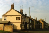 Upp In Arms, High Street, Chatteris. Spade and Becket