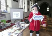Chatteris Town crier supports his local archive at the Saint Peter's church fete presentation.
