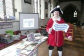 The Chatteris Town Crier, James Carney, supports his local archive at the Community Fayre, church fete presentation.