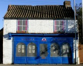 Ex Thorpe shop in Bridge Street, Chatteris decorated with false front for 2007 Chatteris in bloom. (See 2004 photo)