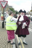 The Chatteris Town Crier prepares to announce the Chatteris Historic Festival parade.