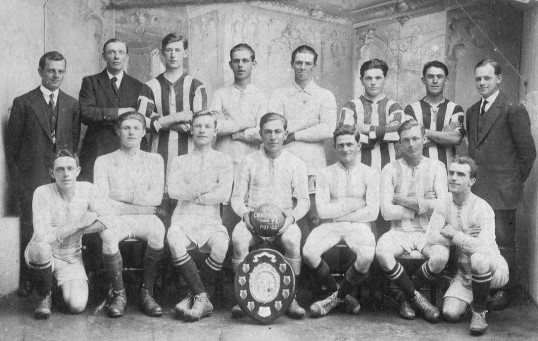 Chatteris Town Football team with Champion shield. From Chatteris museum collection. Fred Kirby holding the ball.