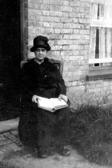 Unidentified lady from C Pope collection of Chatteris photos among post cards lot at auction.