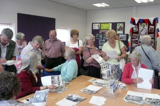 A group of the many visitors to Chatteris ccan Diamond Jubilee 'At home' meeting (held at the Library's Vermuyden Room) identifying names and places.