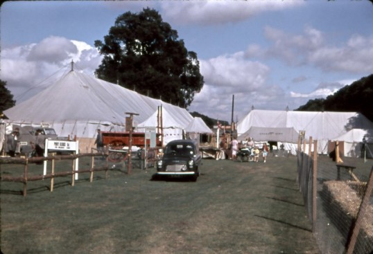 Chatteris Trade Fair. Entrance to showground, with Ford 7 cwt van, parked near old farm cart.Photo by Mr E J TIlley.